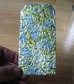 Faux embossed aluminum and alcohol ink