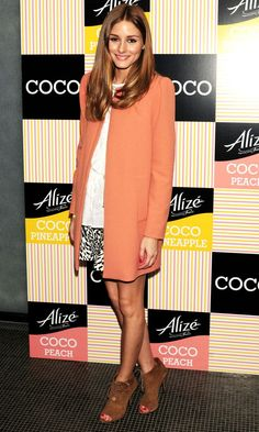Olivia Palermo in a Zara coat and skirt, brown suede boots and a crisp white shirt.