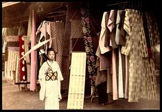 "TAKING A STROLL DOWN KIMONO LANE -- An Open Air Clothing Market in Old Japan by Okinawa Soba, via Flickr. This nice, ""candid"" street scene is about 110 years old."