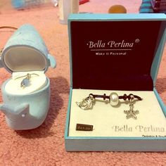 Brand New Dolphin necklace w/ Bella Perlina charms Never Used! One dolphin necklace and 2 charms w/ a dolphin, and a star Bella Perlina Jewelry