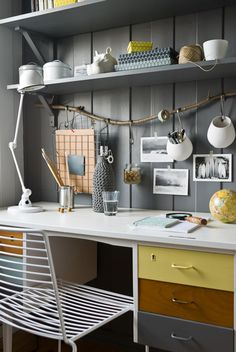 work space with grey walls and colorful accents