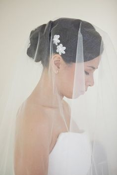 #Veil with tiny flower detail, fun take on the classic long veil! #Wedding Hair Photos on WeddingWire