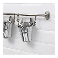 Hang silverware above the sink (buckets and hooks sold separate)
