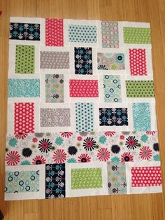 Gracie Girl fabric line - very easy quilt for baby w 1 large feature fabric strip running across, or not.  How about Holiday fabrics with a large border print?
