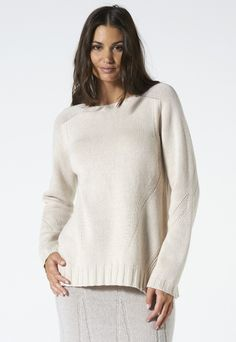 Soft style for this cashmere blend sweater. The crew neck and side splits make this sweater comfortable and ideal for a daytime look. Available in two colours.