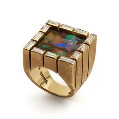 Andrew Grima  Opal Ring, 1973  An exceptional square Opal surrounded by baguette-cut Diamonds in Yellow Gold