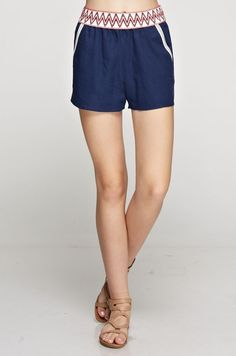 MUST HAVEshorts for Spring! Linen solid shorts with trim detail. Elastic waistline and side pockets. Fits true to size, the model is shown wearing a small.