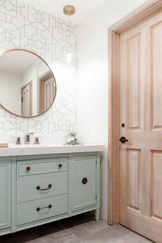 Mint green pattern wallpaper, oversized circle mirror and painted vanity in bathroom remodel by Interior Designer San Diego Savvy Interiors #BathroomRemodel #vanity #roundmirror