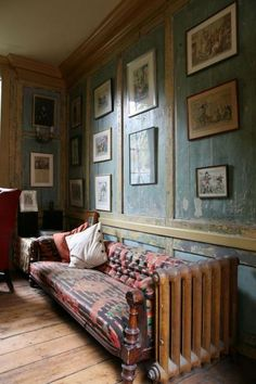 I'm keen on the distressed walls which add a warming rustic touch to the room.