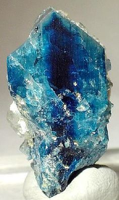 It is related to beryl and other beryllium minerals. It is a product of the decomposition of beryl in pegmatites. Euclase crystals are noted for their blue color, ranging from very pale to dark blue. The mineral may also be colorless, white, or light green.Euclase, from the Greek εὖ, easily, and κλάσις, fracture. The ready cleavage renders the stone fragile with a tendency to chip, and thus detracts from its use for personal ornament.