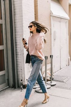 How to style denim with a peach colored sweater