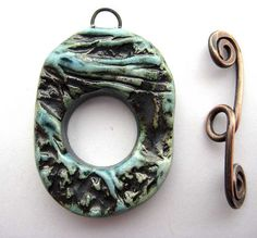Toggle Clasp Waves and Flowers by maryharding, via Flickr  (ceramic clay) ... she has some excellent example of handmade toggles throughout her photostream