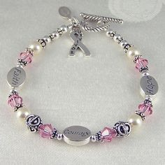 Sterling Silver Bracelet Swarovski Crystal Bracelet Genuine Freshwater Pearl Bracelet Breast Cancer Bracelet Breast Cancer Jewelry. via Etsy.