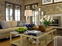 Great living room with a cozy layout, light interior brick walls, light brown and grey furnishings, and a huge bright wood crate inspired coffee table.