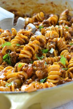 An easy and delicious recipe for One-Pot Cheesy Taco Pasta loaded with ground beef and lots of shredded cheese, ready in about 30 minutes! Mexican Pasta Recipes, Pasta And Mince Recipes, Taco Mince Recipe, Ground Meet Recipes, Meals With Mince Beef, Recipes For Beef, Ground Beef Recipes Simple, Easy Meals With Hamburger Meat, Delicious Pasta Recipes