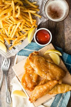Crunchy Beer Battered Fish and Chips! Who doesn't like chunks of white flaky tilapia dipped in a beer batter and fried to a golden perfection. Season with sea salt and black pepper with a side of ketchup.