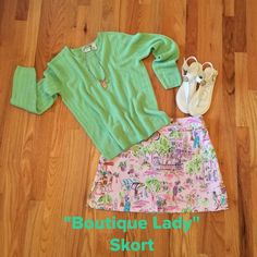 """Boutique Lady Skort This is way too cute. Beautiful colors of a pink background with a multitude of bright colors. Back zip, 5"""" side vents. Measures 16"""" from waist to hem, 16"""" waist, 20"""" hip area. Excellent Condition!!! Dress Barn Shorts Skorts"""
