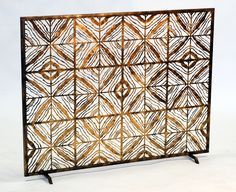 The Egyptian Gold finish on this is so warm and the texture, delicate. Tapestry fire screen from Hearth Art.