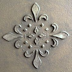Raise plaster stencilled design would like great on front of set of drawers or buffet.