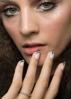 Browse the best nail art ideas from fashion month Spring 2017 at @StyleCaster | Carmen Marc Valvo's black striped tips