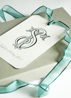 A personalized tag fastened with a light tiffany blue ribbon. Elegant Gift Wrapping, Wedding Gift Wrapping, Creative Gift Wrapping, Monogram Design, Monogram Styles, Monogram Logo, Custom Stationery, Crests, Monogram Gifts