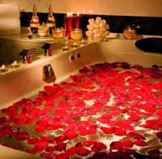 ... with warm water and add a dozen rose's worth of petals and light tea  lights all over the room to create a romantic statement. Draw it for her/  or him ...