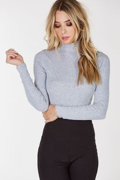 - Turtle neckline - Long sleeves - Ribbed throughout - Side slits - Straight hem - Cotton-Spandex blend - Imported - Model is wearing size S - Runs true to size - Hand wash cold
