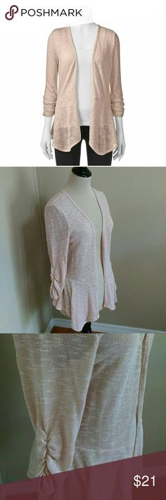 NWT Candie's Drapey Peplum Cardi in Blush Pink Subtle sparkle in this soft and lightweight cardi! A delicious shade of blush pink and flattering drape paired with the girly peplum silhouette really makes this sweater special! You will reach for it again and again - the ultimate anytime sweater - work, weekend and even nice enough to go out on the town with you. Price is firm on this one. Candie's Sweaters Cardigans