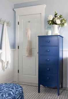 Love this cobalt blue tall dresser for bathroom storage