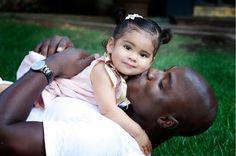 Cowboys linebacker DeMarcus Ware and his baby Marley.