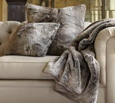 And add a cozy throw to your couch that everyone will want to nap on.