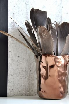 Pin I love this copper vase filled with feathers. This piece could be interchanged from room to room depending on how you feel. The copper teamed with the feathers gives a industrial bohemian feel.