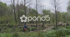 Man on horseback crossing the river the Reartes Cordoba, Argentina - Stock Footage | by BucleFilms