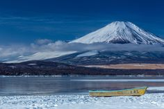 Rowboat at winter lake by Keygee Sekimoto on 500px