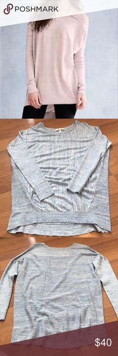 VS Slouchy Tunic Boatneck Sweater New condition. Victoria's Secret Slouchy Tunic Boatneck Sweater. Lightweight material. Ribbed sides and back. Oversized fit (Small). Heathered blue. 🌸Please look at last photo!!! There are some darker blue spots throughout this top. It was made that way, but if you don't like it, please don't buy!!!🌸 Victoria's Secret Tops Tunics