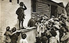 This is brilliant! Somewhere in the slums of east London, a young boy, with hat and shoes approximately 5 sizes too big, stands on an upturned water tank and entertains the audience with his Charlie Chaplin impersonation. Old Pictures, Old Photos, Vintage Photos, Vintage London, Old London, East London, London History, British History, The Great Fire