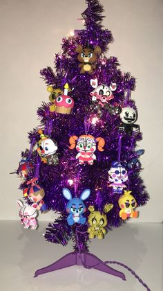 """fluffyexplorers: """"Happy holidays! Here's a FNAF Christmas tree! I turned the mini figures into decorations! The tree is purple lol """""""