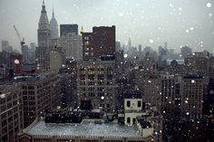 capturing the falling snow was a great touch! Also love the tones of the city