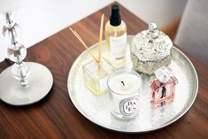 Place perfume and candles on a silver tray to rotate them.