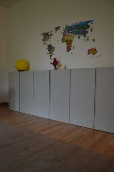 Ikea Ivar cabinets painted in Farrow & Ball Light Grey and vintage balloon lamp Yves Christin. The map sticker was on the wall already. Ola Kelly. Dusseldorf 2013