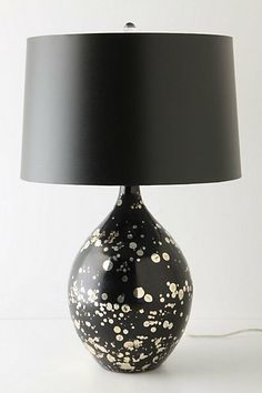 Hand-blown and gold-spattered glass make this one-of-a-kind lamp an interesting addition to any room!