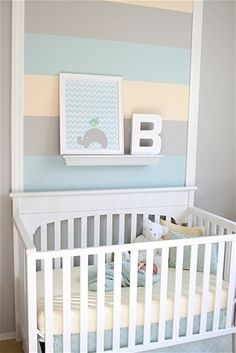 A break from the traditional primary color scheme for baby boys, we're fans of the softer, lighter, sweeter colors used in this nursery. Also, this room proves that you don't need to paint an entire wall in stripes in order to get the great effect - just highlight the area behind the crib for an adorable touch.