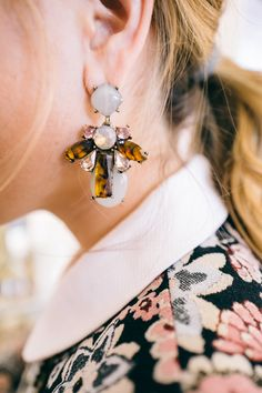 These tortoise earrings are a buttoned-up classic. (Image via Gal Meets Glam)