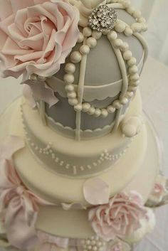Light pink, silver, and ivory cake with pearl and rose embellishments! #wedding