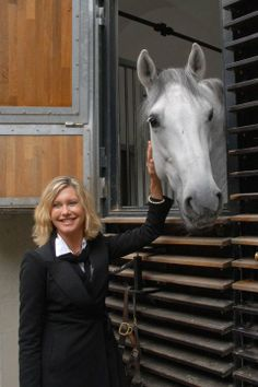 In September 2010, the world famous singer-actress Olivia Newton-John visited the Spanish Riding School in Vienna during her trip to the city for the Pink Ribbon Gala