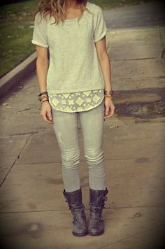 I like the lace shirt hanging under the sweat shirt to dress it up a bit.