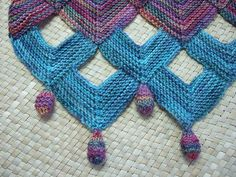 Garter stitch is simple, but this design is so stunning. Would make an amazing edge for a scarf or shawl.