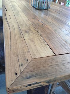 Dining table crafted from reclaimed hardwood timber, with feature rusted steel legs.