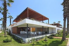Situated in Lima, Peru, this modern single family residence was designed in 2012 by Martin Dulanto.