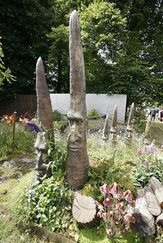 """unusual sculptures"" (faces carved into used palm tree trunks?) at the Hampton…"